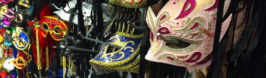 A photograph showing our store's selection of masquerade masks. About sixty styles visible.